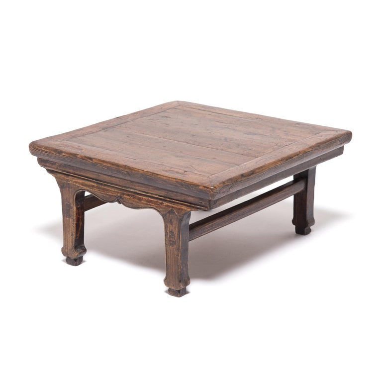 This lovely, low-profile table once served up wine, food, and board games to guests who sat or reclined on a platform or floor. Made of northern Chinese Elmwood, the petite table is detailed with a carved scroll apron and charming hoof feet. A sign