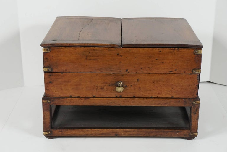 This box built on a raised openwork stand is a lovely old example of Chinese provincial furniture construction. Made circa 1880 the piece shows long years of use and love with a very nice old surface and patina. The top has two lids that remove and