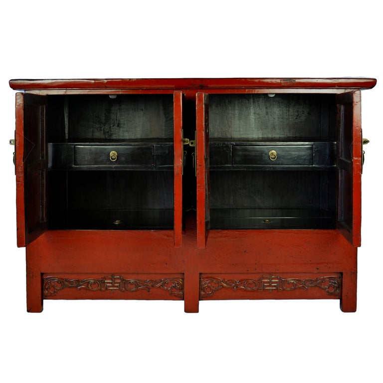 Since traditional 19th century Chinese homes were built without closets, this red lacquer chest would have been used for general storage. The centre of each apron is carved with the symbol for longevity amidst trailing vines. The red lacquer finish