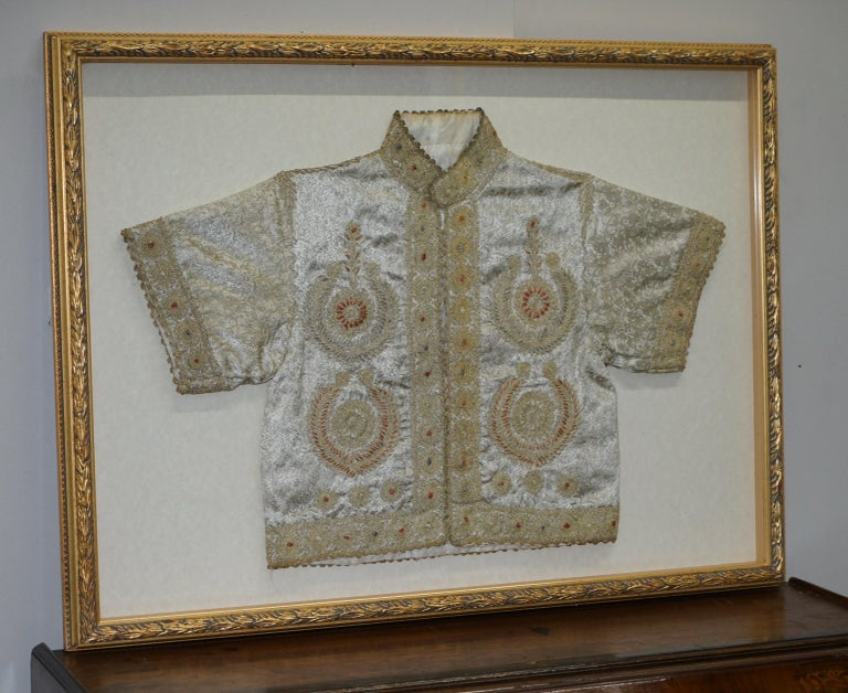 We are delighted to offer this very rare 19th century Chinese silk embroidered ceremonial robe in a lovely glass picture frame display case