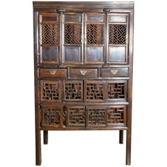 19th Century Chinese Stained Cabinet with Fretwork Doors and Three Drawers