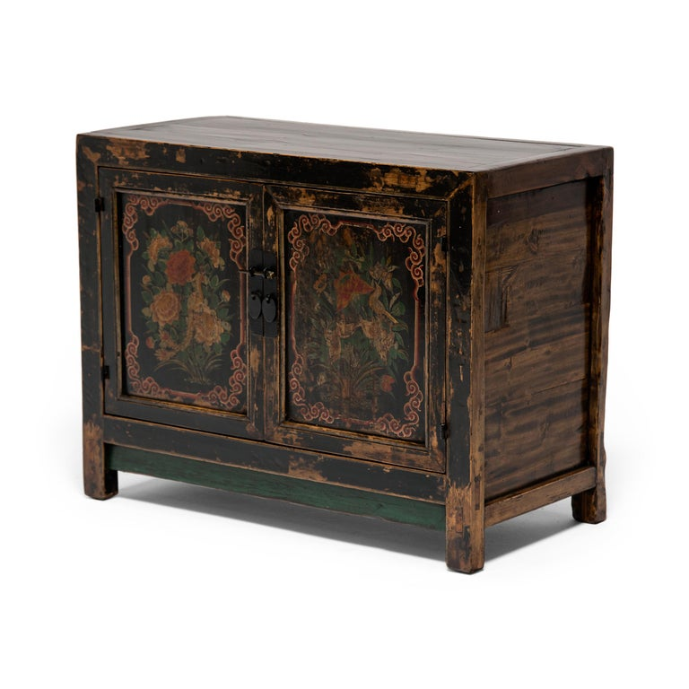 The form of this low square-corner chest from northern China has a rustic simplicity that modern furniture designers often try to replicate. The cabinet's minimal frame and open flat surfaces provided the maker with an irresistible canvas upon which