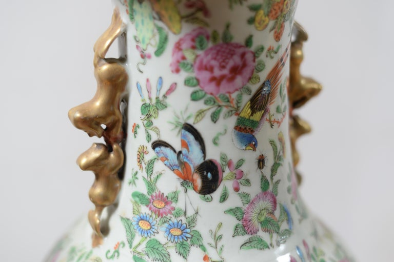 19th century Chinese vases, butterfly decor, flowers, birds, pink period, porcelain, no frail no chips in very good condition. Measures: Diameter of the neck 22 cm, height 63 cm, 70 cm total height with the wooden base.