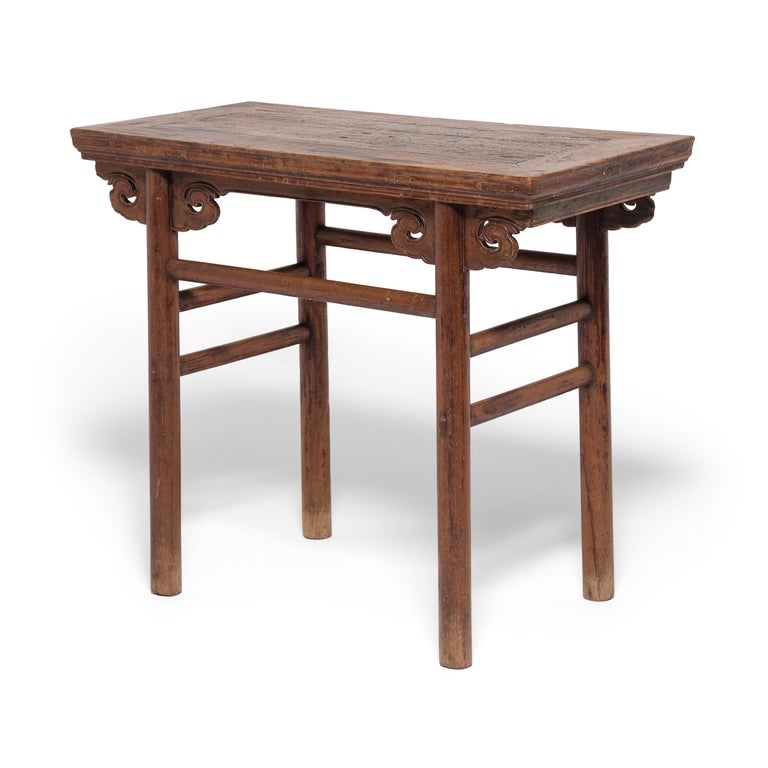 Ideal as a console table in the modern home, this exquisite 19th century wine table charms with rounded legs, simple double stretchers, and finely beaded cloud spandrels. Crafted in China's Shanxi province over over one hundred and fifty years ago,