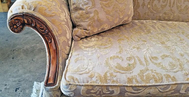 Presenting a gorgeous early 19th century Chippendale style camel back sofa possibly made in Louisiana. From circa 1820 this sofa is in the classic Chippendale camel back style with gorgeous carving and detail on the wood.  Made of blonde walnut,