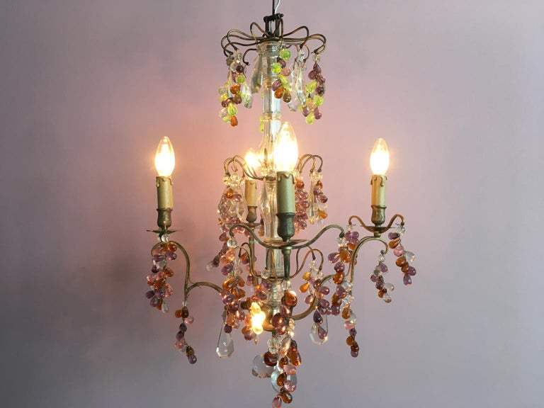 A unique lead crystal chandelier from France. The colorful crystal drops and balls in purple and lime green and the small, clear apples make him one of my absolute favourite pieces.