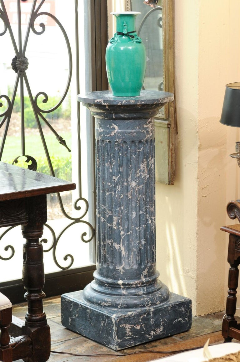 The 19th century continental blue marbleized painted terracotta pedestal featuring fluting detail and square base.