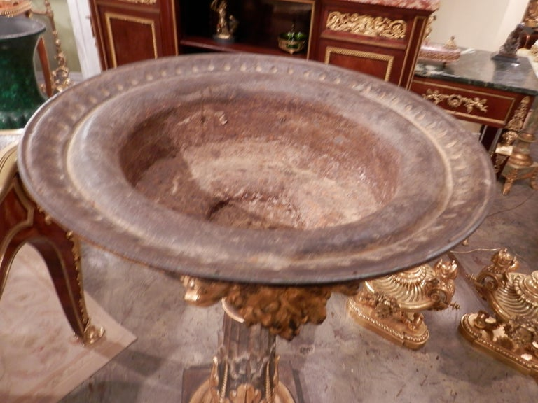 Large and impressive 19th century Continental iron and parcel gilt fountain or birdbath. Beautiful detail and quality.