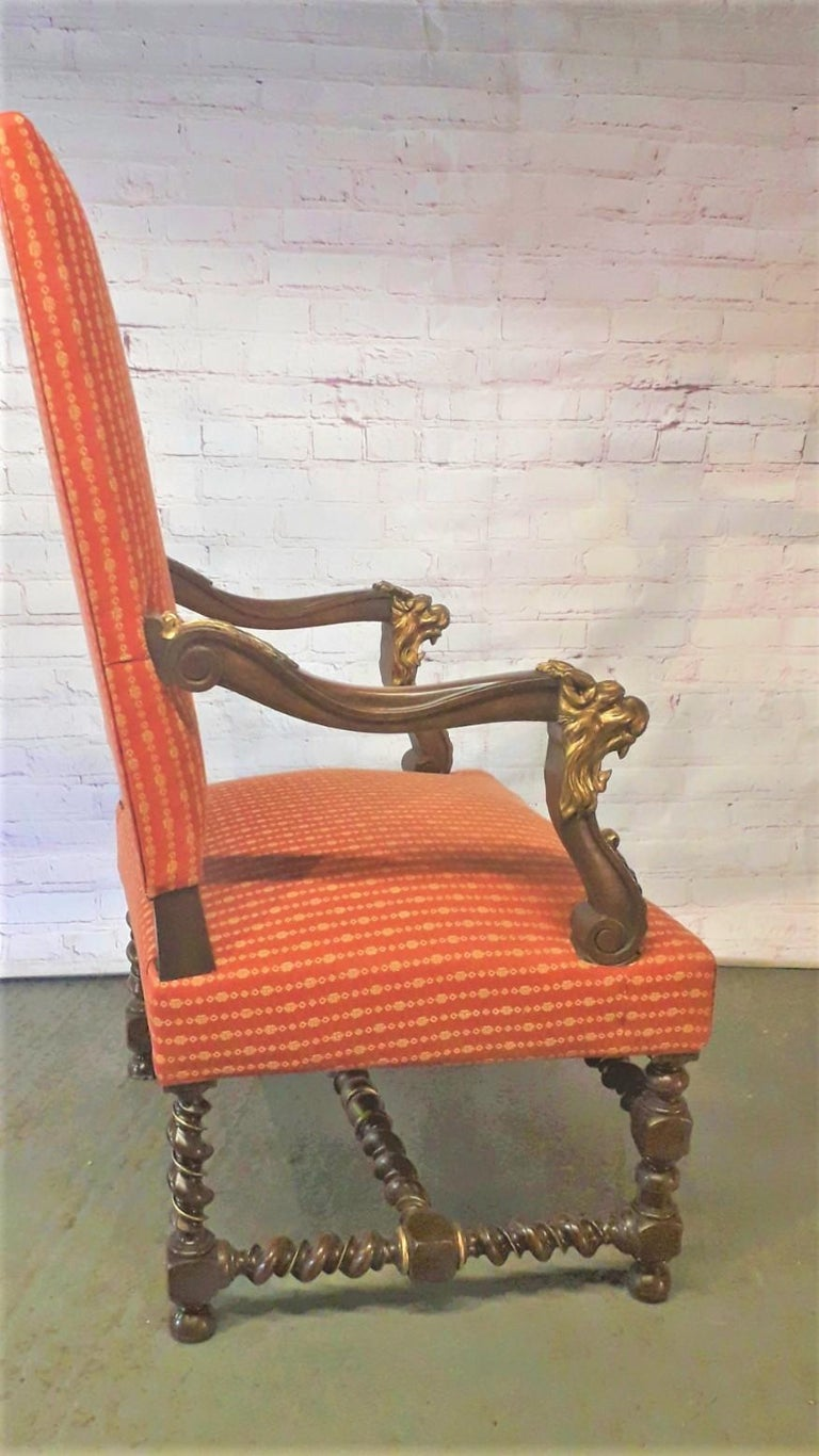 A fabulous pair of parcel gilt walnut armchairs with rare double barley twist turnings, the open scrolled arms carved with lion mask heads set on arms with gilded brackets, the bun feet supported by turned legs with superb gilded motifs.  We can