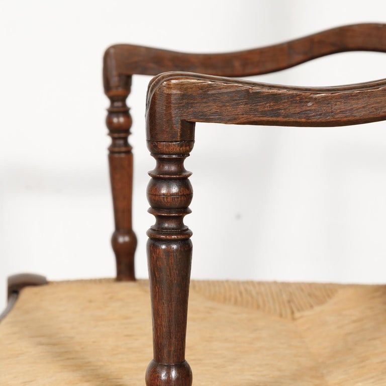 19th Century Country French Hand Carved Oak Rush Seat Armchair For Sale 7