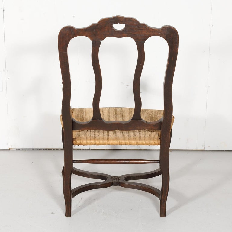 19th Century Country French Hand Carved Oak Rush Seat Armchair For Sale 10