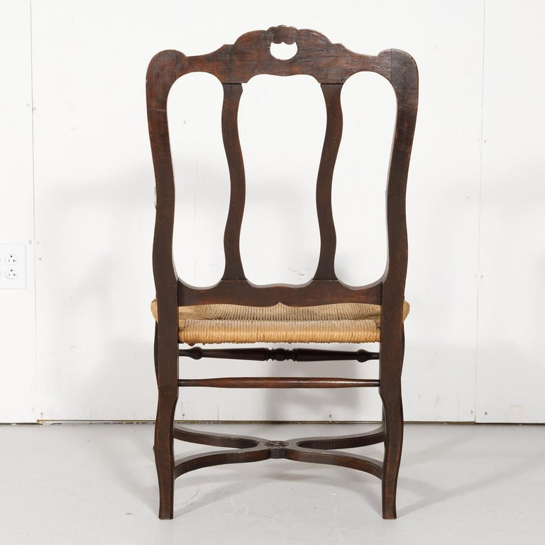 19th Century Country French Hand Carved Oak Rush Seat Armchair For Sale 11