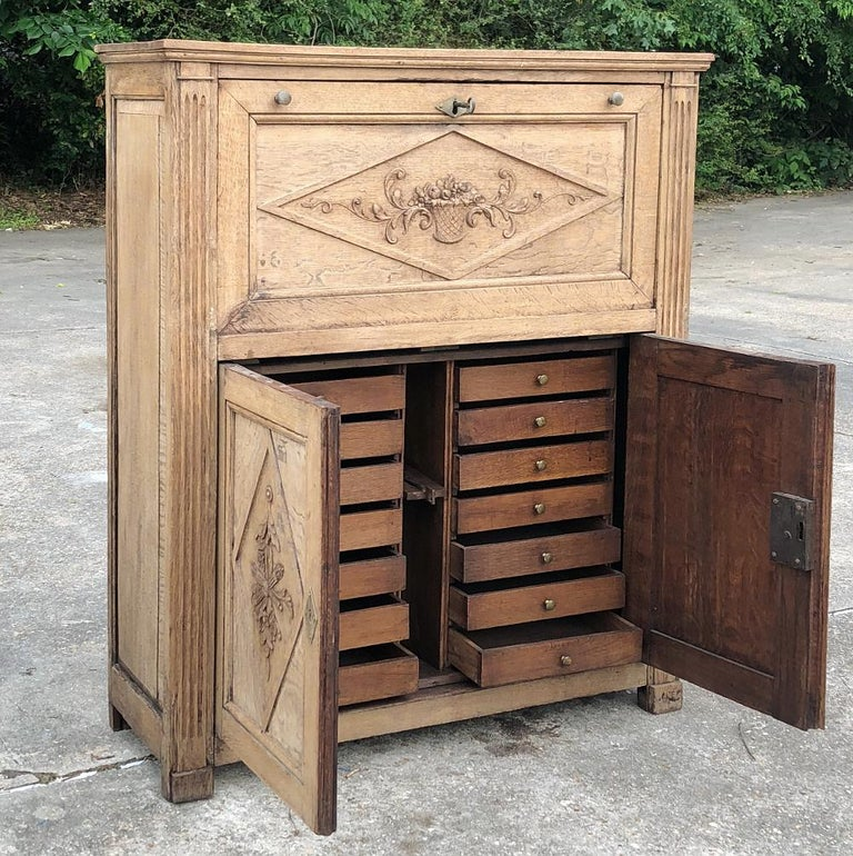 19th century country French rustic stripped secretary is great for the home office, a student desk, or even for use as a bar in the game room! Multiple drawers below combine with a large work surface and cabinet above, with subtle neoclassical