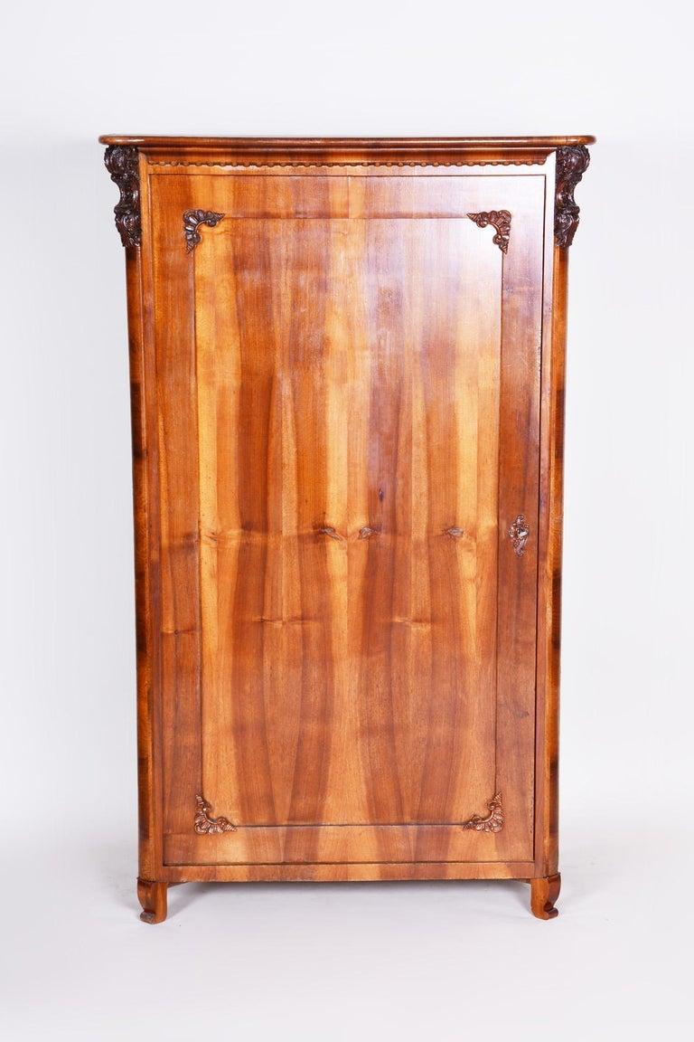 Completely restored Czech one door Biedermeier wardrobe cabinet. Source: Bohemia (Czechia) Period: 1840-1849 Material: Walnut.