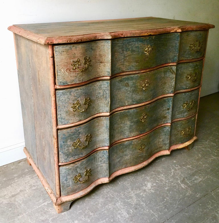 An exceptional 19th century Danish Rococo chest in brilliant time worn original paint with beautifully carved serpentine drawers with original handsome bronze escutcheons, Denmark, circa 1880. Surprising pieces and objects, authentic, decorative