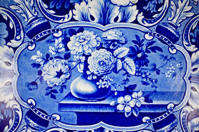 """From the Davenport pottery, Longport, Staffordshire, England, an oversize earthenware, underglaze tissue printed platter, in the """"Vase with Medallions of Flowers"""" pattern.   An impressed mark on the verso used circa 1815-1860.  A complex blue on"""