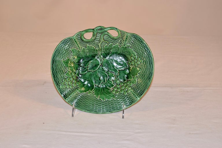 19th century signed Davenport majolica dish in vibrant green. The handle of the dish are molded to look like vines and the rim in a woven basket patter, with a central design of leaves and grapes. Excellent crisp pressing of the mold.