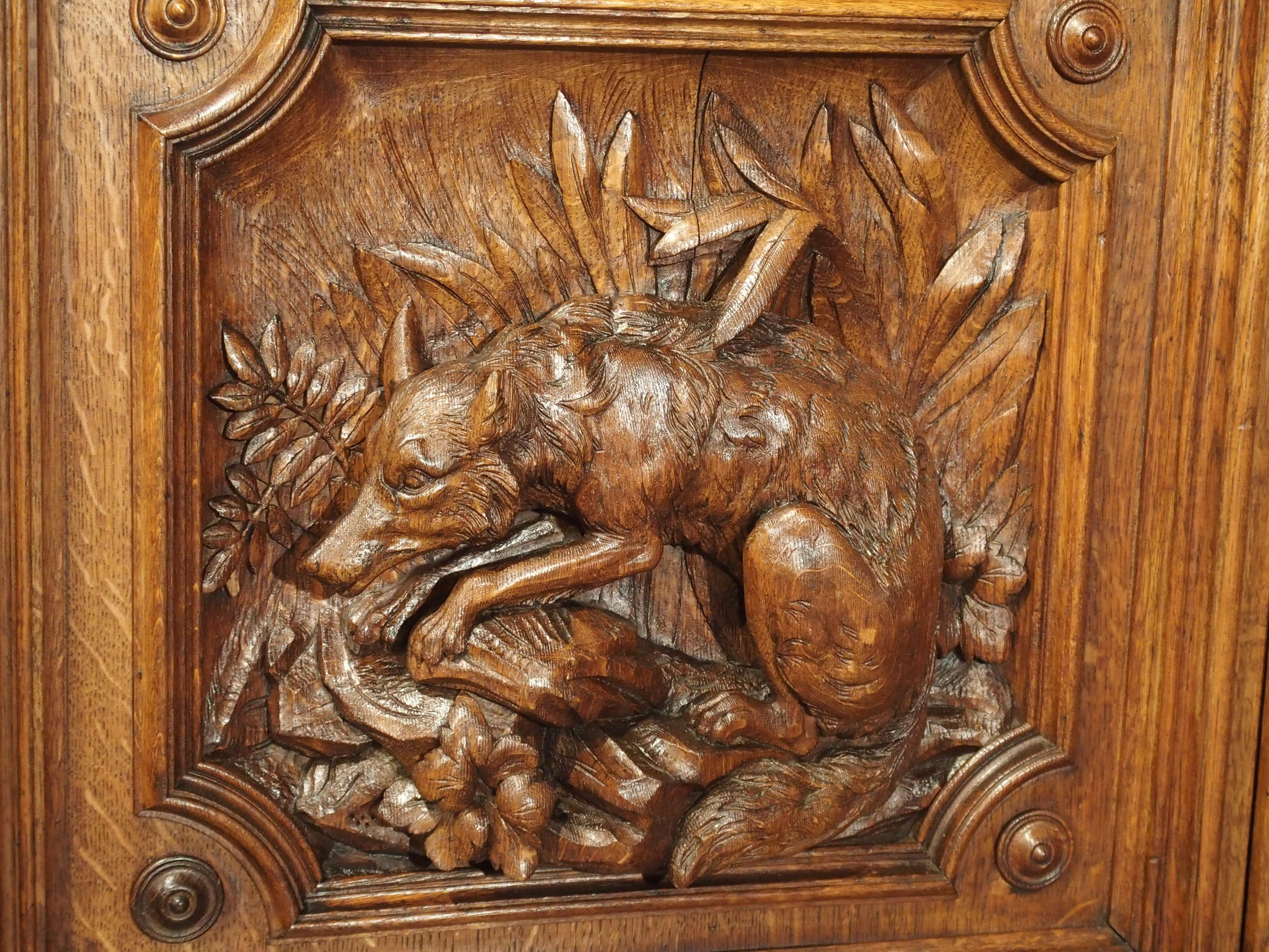 Th century demilune french oak hunt buffet with deep relief
