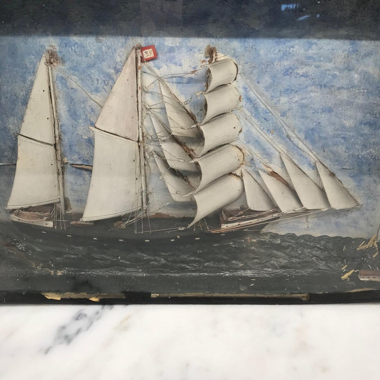 Early 19th century diorama of a three masted ship in full sail in a choppy sea of white-capped white waves amidst blue skies. In original framed glass shadow box. #4293.