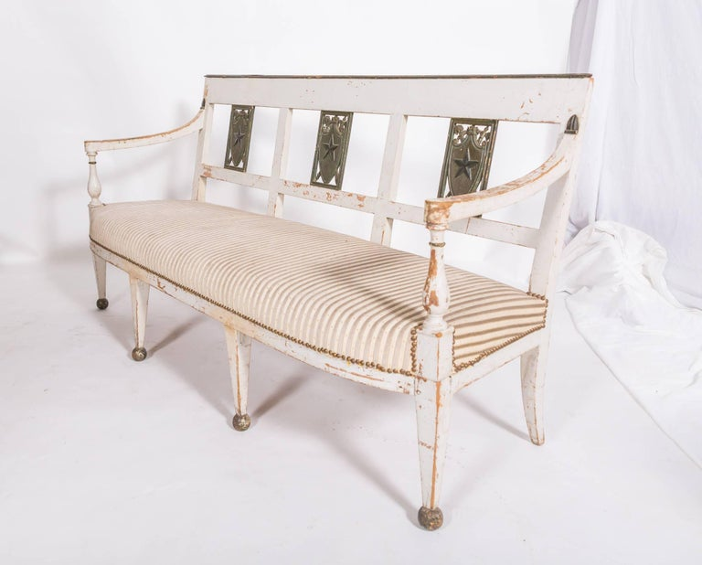 Directoire bench with detailed neoclassical carving. Chic proportions and clean classic style.