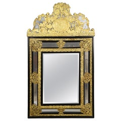 19th Century Dutch Baroque Style Ebonized and Repoussé Gilt Metal Framed Mirror