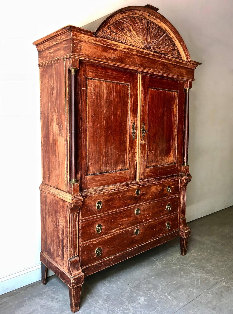 Handsome and usual 19th century Dutch Cabinet with richly carved bonnet in original patina and lot of storage.