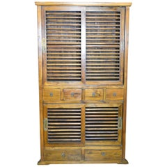 19th Century Dutch Colonial Armoire with Fretwork Sliding Doors and Drawers