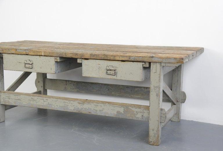 19th century Dutch farm workbench  - Original paint - Think pitch Pine top - 2 large drawers with original handles - Originally used in a farm workshop in Eastern Holland - Dutch ~ 1880 - Measures: 230cm long x 94cm deep x 83cm