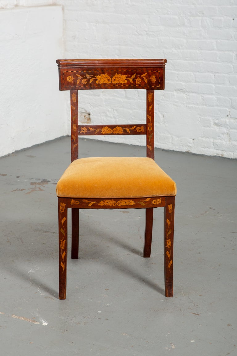 19th century Dutch marquetry side chair with new velvet upholstery. Carved wood floral details throughout. Curved back and curved and tapered legs. Wood is in very good original condition.