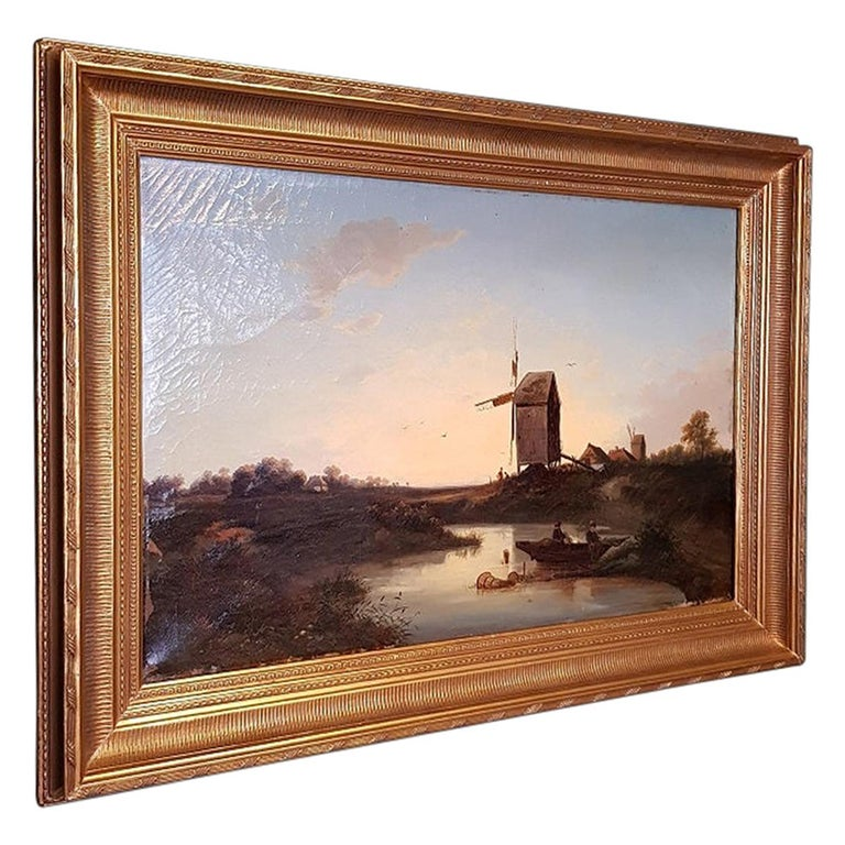 Antique Dutch School oil painting on canvas and attributed to Johannes Hilverdink, depicting a polder landscape of fishermen at a mill in a new gilt frame, it has some paint loss in the left corner and in a reasonable condition around crackle.