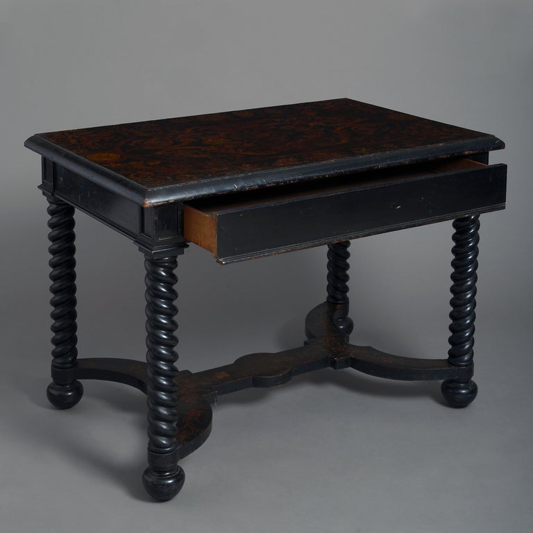 A fine early 19th century ebonized centre table in the 17th century manner, having a faux marquetry rectangular top, with central drawer and raised upon barley twist legs with conjoined decorated stretcher.