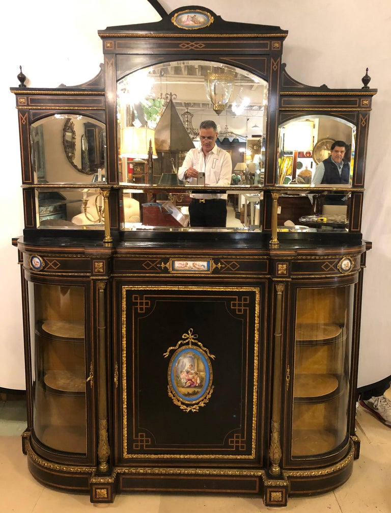 19th century ebonized bronze mounted sideboard with matching mirror. This finely constructed sideboard can be used with or without the matching mirror. The mirror is sold separately or with the item as is seen in this listing. The sideboard having