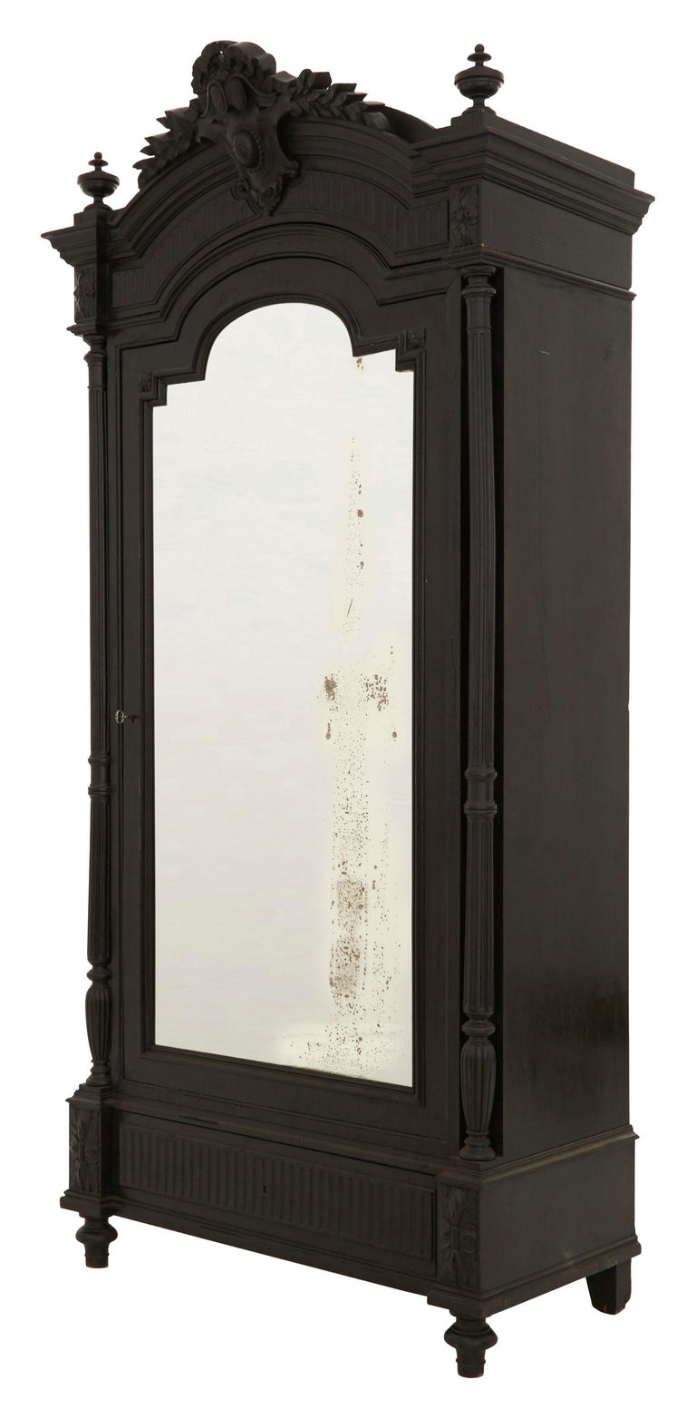 French 19th Century Ebonized Carved Wood Armoire For Sale