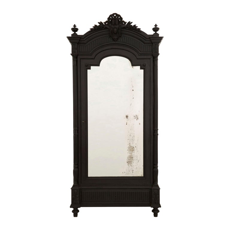 19th Century Ebonized Carved Wood Armoire For Sale