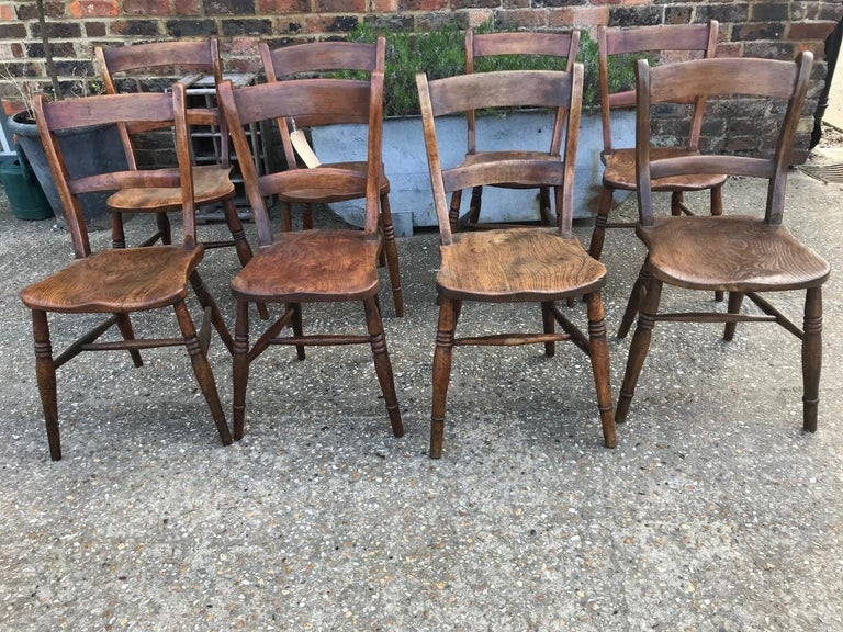 Harlequin Set Of Eight 19th Century Elm and Beech Windsor Bar Back Chairs For Sale 1