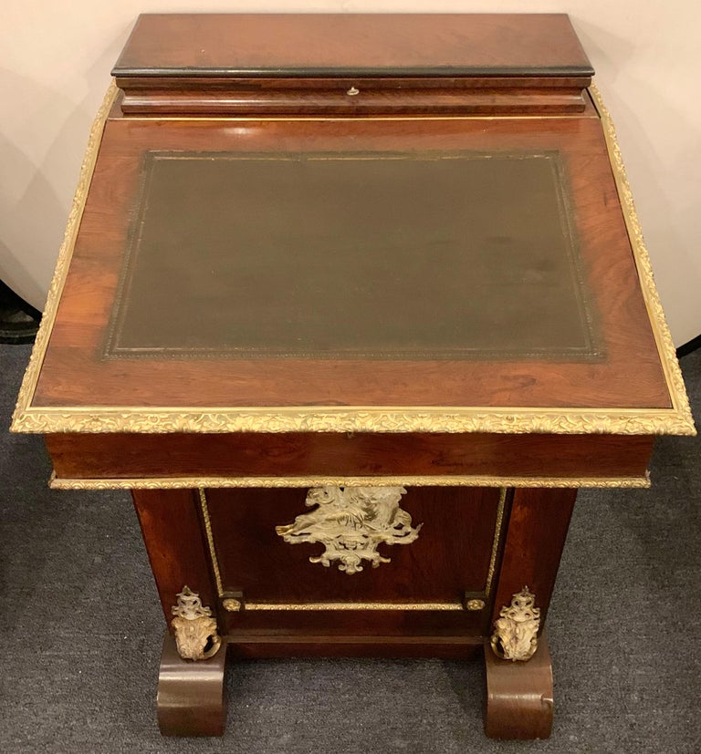 19th century Empire bronze mounted antique davenport desk. This desk has been fully refinished and can sit in the center of any room as it is finished on all sides.  Greg hSXX/ESXA.