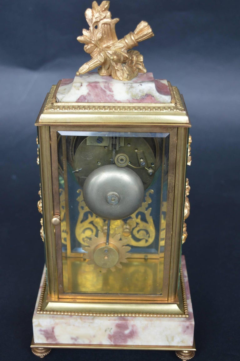 Empire style clock with gilt bronze and marble. Stamped Medaille D'argent Vincenti clock, 1855. Clock is in working condition.
