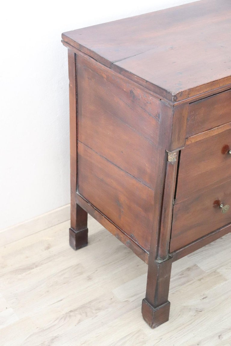 Important antique Italian chest of drawers 1880s in walnut wood. The commode is very refined linear and elegant. On the front three large drawers with two black columns at the sides enriched with gilded capitals. Very elegant commode ideal in every
