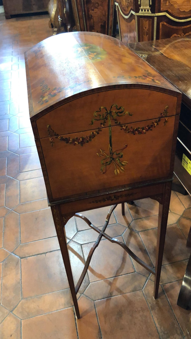 Dome top work box it is a rare piece in Satinwood, late Victorian period, hand painted...superb a Sheraton Revival, a revival that looks original for its superb workmanship, done superlatively. The paintings are in exceptional condition and of great