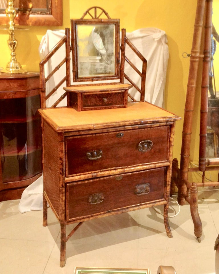 A charming dresser of small proportions with good detail around the mirror.