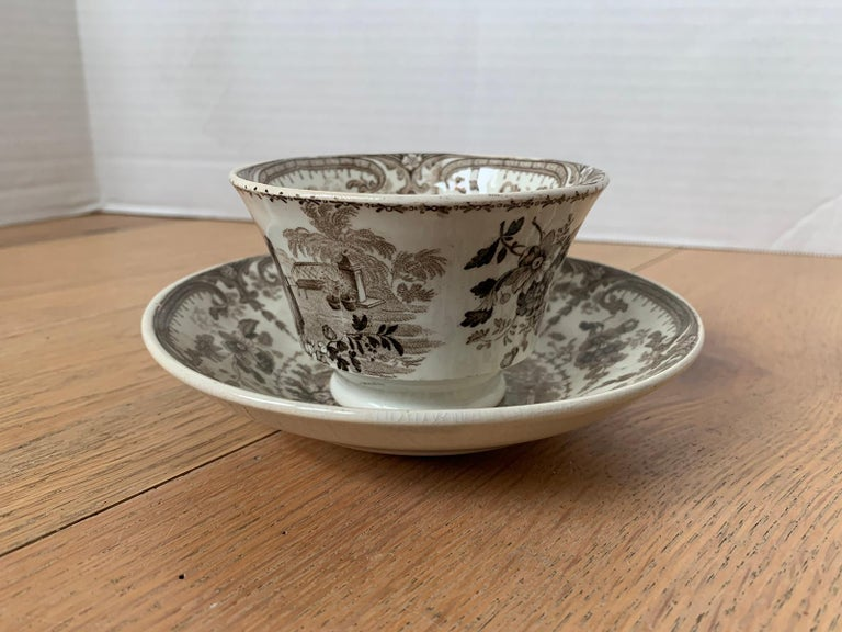 19th century English brown transferware porcelain cup and saucer with opaque China factory mark.