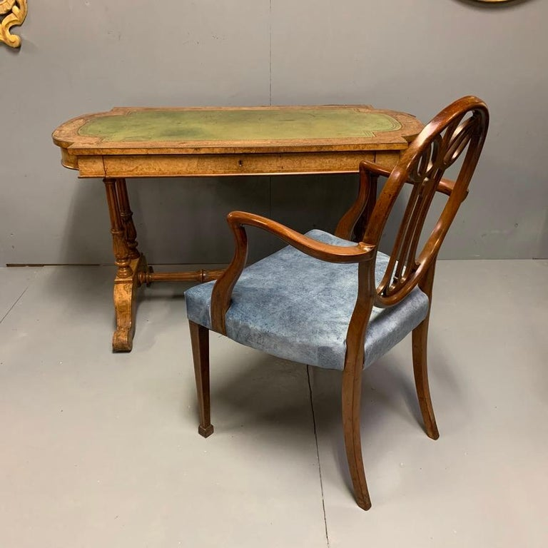 This really is an outstandingly good quality 19th century English burr walnut writing table with marquetry, box stringing and fine brass mounts, finished with a fabulous sage green and gilt tooled leather top. The colour to this piece is really