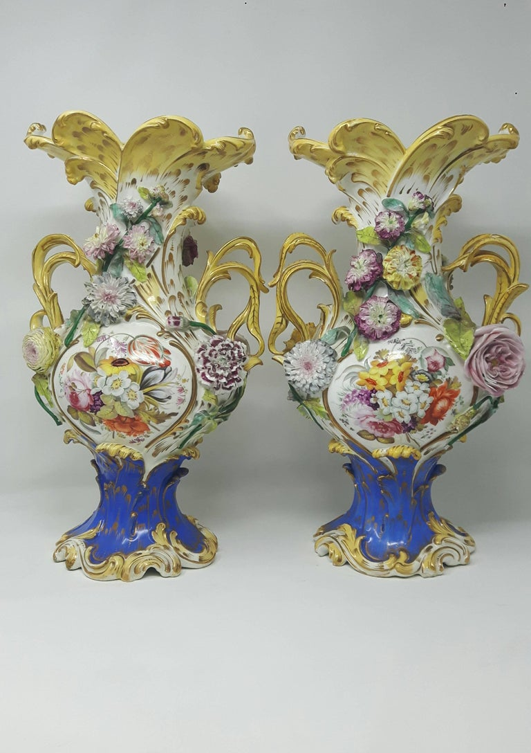 Pair of 19th century Coalport vases encrusted with finely modeled flowers and branches.