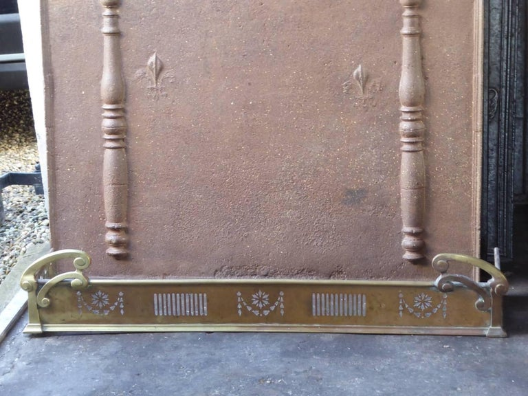 19th century English fire fender made of brass.  We have a unique and specialized collection of antique and used fireplace accessories consisting of more than 1000 listings at 1stdibs. Amongst others, we always have 300+ firebacks, 250+ pairs of