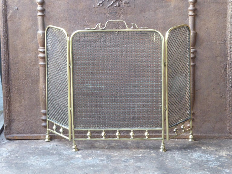 19th century English Victorian fireplace screen made of polished brass and iron mesh.  We have a unique and specialized collection of antique and used fireplace accessories consisting of more than 1000 listings at 1stdibs. Amongst others, we