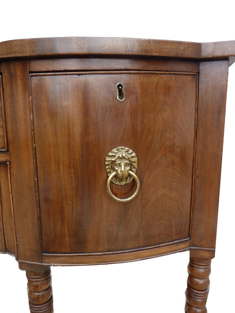 For sale is a good quality George III mahogany sideboard of small proportions. The sideboard has four drawers, each with original brass handles. The sideboard stands on 6 elegant turned legs. This piece is in a good untouched condition though there