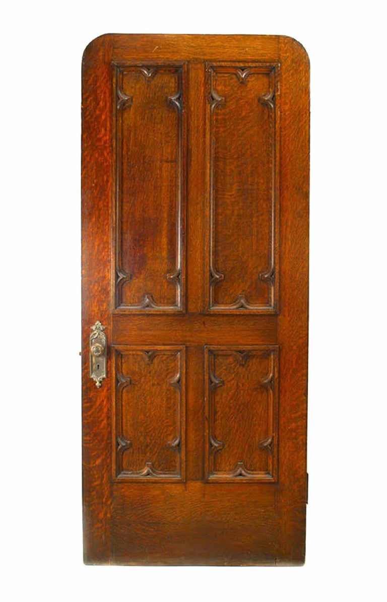 English Gothic Revival style oak carved door with four wood panels (19th century)