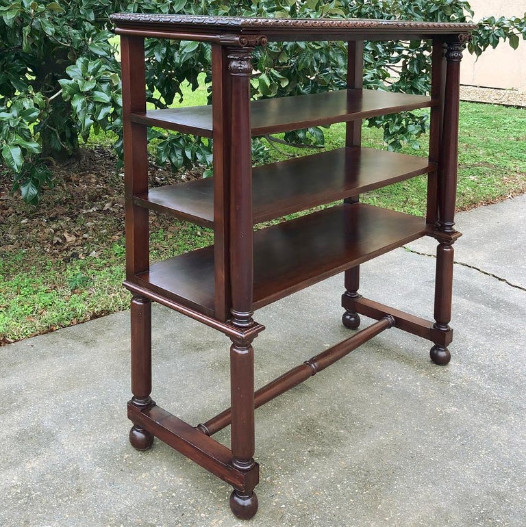 19th century English mahogany bookshelf is the perfect choice for creating a light and airy appearance, yet performing yeoman's work by supplying four surfaces upon which one can place books, decorative items, family photos, or whatever else suits
