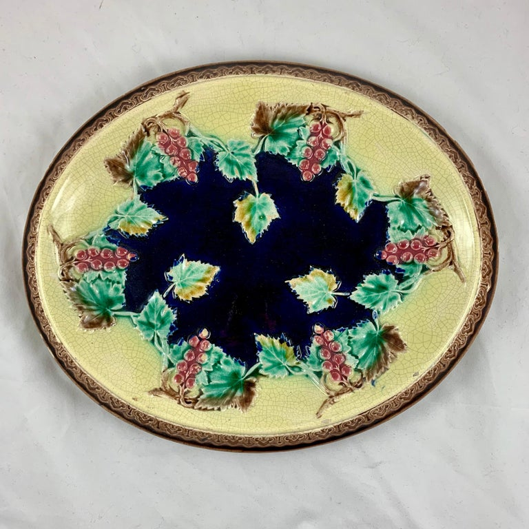 A Victorian English Majolica platter suitable as a cheese board or a bread tray, circa 1880-1885. 