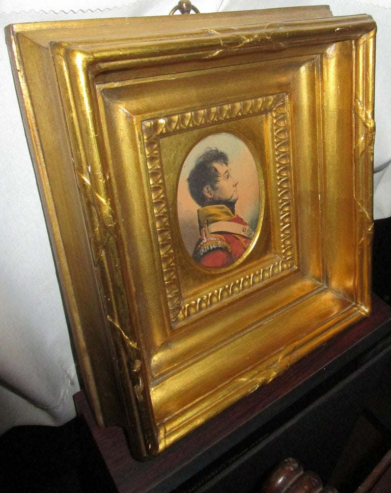 Early 19th century English Napoleonic War Soldier oval watercolor nicely executed in a small size with lovely color and detail. The decorative dimensional gold gilt deep wooden frame features convex glass and the edges are scored with crossed